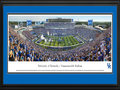 Picture: Just out from the 2015 home and season opening game against Louisiana-Lafayette! Kentucky Wildcats football Commonwealth Stadium 13.5 X 40 panoramic print professionally double matted in team colors and framed to 18 X 44. This panorama, taken by James Blakeway, captures the excitement of the University of Kentucky football team kicking off their season opener and a new era of the program in The New Commonwealth Stadium. The $126 million dollar reinvention of the stadium includes brand new concessions, enhanced and widened concourses throughout the complex, and an exterior facelift featuring Kentucky limestone. The new student section and multi-purpose recruiting center in the east end zone are at the heart of the stadium upgrade.