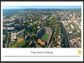 Picture: Georgia Tech Yellow Jackets Bobby Dodd Stadium 13.5 X 40 panoramic print professionally framed to 13.75 X 40.25. This aerial panorama of Georgia Institute of Technology, taken by George Pearl, spotlights Bobby Dodd Stadium at Historic Grant Field. Originally built in 1913 by the Georgia Tech student body, it is the oldest on-campus stadium in NCAA Division I-A. Known as Grant Field since 1914, the name Bobby Dodd Stadium was added in April 1988, in honor of the legendary coach. A stadium expansion was completed in 2003, raising capacity to 55,000 seats. The Yellow Jackets football team, which began in 1892, has won a total of 15 ACC titles, 4 national titles and has played in 35 bowl games. With more than 18,000 students, Georgia Tech occupies 400 acres in the heart of Atlanta.