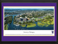 Picture: Washington Huskies Husky Stadium and the University of Washington 13.5 X 40 panoramic poster professionally double matted in team colors and framed to 18 X 44. This aerial panorama of the University of Washington was taken by Christopher Gjevre during a Washington Huskies football game. Centered in the photo is the newly-renovated Husky Stadium, which originally opened in 1920. It is the most scenic football structure in the nation, with seating capacity for 70,138 fans. Overlooking Union Bay on scenic Lake Washington to the east and the Olympic Mountains to the west, the stadium is unique in that fans can attend games by boat. The Portage Bay waterway and the nationally ranked University Medical Center are left of the stadium. Hec Edmundson Pavilion, the main campus, and the UW Tower are to the right.