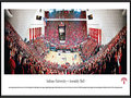 "Picture: Indiana Hoosiers Assembly Hall 13.5 X 40 panoramic poster professionally framed. This panorama, taken by James Blakeway, captures the Indiana Hoosiers impressive win over the North Carolina Tarheels, and the first night of the season's ACC/Big Ten Challenge between two of the most storied programs in all of college basketball. Adding to the evening festivities at Assembly Hall in Bloomington, Indiana, Hoosier fans were dressed in red to celebrate the ""Red Out"" game and, as tradition has dictated since 1979, the William Tell Overture played during the third time-out of the second half of the game. The Hoosiers have been part of the Big Ten Conference since 1899, fielded their first men's basketball team in the 1900-01 season and hold a long history of winning achievements."