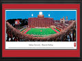 "Picture: Indiana Hoosiers Memorial Stadium 13.5 X 40 panoramic poster professionally double matted in team colors and framed to 18 X 44. This panorama of Memorial Stadium, taken by Christopher Gjevre, highlights the action of an Indiana Hoosiers football game. Memorial Stadium, located in Bloomington, Indiana, opened in 1960. It replaced the ""old"" Memorial Stadium, a 20,000 seat stadium built in 1925. After many renovations, seating capacity now holds 52,692. The Hoosiers football program began in 1887 and competes in the Big Ten Conference. Established in 1820 as the Indiana State Seminary, eight years later the name was changed to Indiana College and officially changed to Indiana University in 1838. Indiana University enrolls 107,000 plus students at all IU campuses."