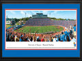 "Picture: Kansas Jayhawks Memorial Stadium 13 X 40 panoramic print professionally double matted in team colors and framed to 18 X 44. This panorama, taken by James Blakeway, features Memorial Stadium - home to the Kansas Jayhawks football team. Kansas played its first game in Central Park in 1890. Two years later, they moved to McCook Field. In 1921 the Jayhawks moved again into Memorial Stadium, the first college campus stadium built west of the Mississippi River. It is the seventh-oldest college stadium in the nation with capacity at 50,071. It is dedicated to the University of Kansas students who fought and died in World War I. The Jayhawks have appeared in 11 bowl games and won or shared 6 conference titles in its history. Traditionally, fans chant ""Rock Chalk, Jayhawk"" during games. The University, founded in 1865 in Lawrence, Kansas, educates 29,613 students."