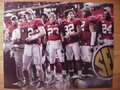 Picture: Alabama Crimson Tide 2009 SEC Champions image 12. We are the exclusive copyright holders of this image. Greg McElroy holds the 2009 SEC Championship trophy with Nick Saban and other players in the background original 12 X 18 panoramic photo.