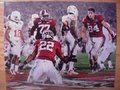 Picture: Alabama Crimson Tide 2009 National Championship 16 X 20 print features Mark Ingram scoring a touchdown against Texas with Colin Peek nearby. This print fits a standard frame so you can have a nice large framed National Championship piece at a very affordable price.