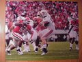 Picture: Georgia Bulldogs 8 X 10 photo of the defense against Auburn in the team's 45-7 win professionally double matted to 11 X 14.