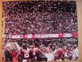 Picture: This is an original Alabama Crimson Tide 2011 BCS National Championship game photo/poster of Nick Saban and the team with confetti all around them after the school's 14th National Championship.