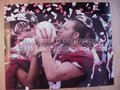 Picture: Alabama Crimson Tide 2011 BCS National Championship photo of a player kissing the 2011 National Championship Football Crystal.