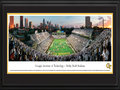 Picture: Georgia Tech Yellow Jackets Bobby Dodd Stadium 13.5 X 40 print professionally double matted in team colors and framed to 18 X 44. This panorama of the 100th anniversary of Historic Grant Field was taken by James Blakeway. Bobby Dodd Stadium at Grant Field, originally built in 1913, has been home to Georgia Tech football for more than a century. One of the best venues in the country to watch college football, the facility is the oldest on-campus stadium in NCAA Division 1-A (FBS). The facility was known as Grant Field until 1988, when the name Bobby Dodd Stadium was added in honor of the legendary coach who guided the Rambling Wreck to an illustrious football era. In true Georgia Tech style, the Rambling Wreck rolled onto the field and fans dressed in white at this nationally televised event.