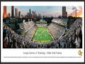 Picture: Georgia Tech Yellow Jackets Bobby Dodd Stadium 13.5 X 40 print professionally framed to 13.75 X 40.25. This panorama of the 100th anniversary of Historic Grant Field was taken by James Blakeway. Bobby Dodd Stadium at Grant Field, originally built in 1913, has been home to Georgia Tech football for more than a century. One of the best venues in the country to watch college football, the facility is the oldest on-campus stadium in NCAA Division 1-A (FBS). The facility was known as Grant Field until 1988, when the name Bobby Dodd Stadium was added in honor of the legendary coach who guided the Rambling Wreck to an illustrious football era. In true Georgia Tech style, the Rambling Wreck rolled onto the field and fans dressed in white at this nationally televised event.