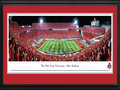 Picture: Ohio State Buckeyes Ohio Stadium 13.5 X 40 panoramic print professionally double matted in team colors and framed to 18 X 44. This panorama of Ohio Stadium showcases The Ohio State University Marching Band performing �Script Ohio,� moments before The Ohio State Buckeyes® played to victory over the Wisconsin Badgers. Of all the traditions in Ohio State�s great football history, the most widely recognized and greatest spectacle in college sports is the Script Ohio, the formation performed by the band each and every game day. In addition, the tradition of dotting the �I� dates back to 1936 and was invented by a sousaphone player. To this day, only sousaphone players with a minimum of 4 years membership are allowed to dot the I.
