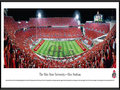 Picture: Ohio State Buckeyes Ohio Stadium 13.5 X 40 panoramic print professionally framed to 13.75 X 40.25. This panorama of Ohio Stadium showcases The Ohio State University Marching Band performing �Script Ohio,� moments before The Ohio State Buckeyes® played to victory over the Wisconsin Badgers. Of all the traditions in Ohio State�s great football history, the most widely recognized and greatest spectacle in college sports is the Script Ohio, the formation performed by the band each and every game day. In addition, the tradition of dotting the �I� dates back to 1936 and was invented by a sousaphone player. To this day, only sousaphone players with a minimum of 4 years membership are allowed to dot the I.