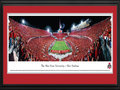 Picture: Ohio State Buckeyes Ohio Stadium 13.5 X 40 panoramic print professionally double matted in team colors and framed to 18 X 44. This panorama of Ohio Stadium, spotlights The Ohio State Buckeyes® scoring one of four game-winning touchdowns against their Big 10 Conference opponent, the Wisconsin Badgers. The Buckeyes first big game of the season turned Ohio Stadium, also known as The Horseshoe, or The Shoe, into the most-scarlet place on earth. Almost everyone in the crowd of 105,826, the third-largest in Ohio State history, was donning the Buckeyes� shade of red. The Ohio State University football team played their first game on May 3, 1890. Ohio Stadium is listed in the National Registry of Historic Places and has been home to Buckeye football since 1922.