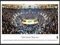 "Picture: Purdue Boilermakers Mackey Arena 13.5 X 40 panoramic poster professionally framed to 13.75 X 40.25. This panorama of Mackey Arena, taken by James Blakeway, highlights the Purdue Boilermakers men's basketball team playing before a sold-out crowd. Originally opened as Purdue Arena in 1967, it was renamed in 1972 to honor long-time athletics director and Purdue alum Guy ""Red"" Mackey. The arena stadium seats 14,123 fans and is considered one of the loudest in the nation. The men's basketball program started in 1896, competes in the Big Ten Conference and has won more league championships than any other school in the conference. Established in 1869 in West Lafayette, Indiana, the University today enrolls more than 39,000 students."
