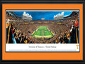 "Picture: Tennessee Volunteers Neyland Stadium panoramic poster professionally double matted in team colors and framed. This panorama, taken by James Blakeway, spotlights the Tennessee Volunteers famous pregame football show that includes the ""Opening of the Power T,"" as the team runs onto the field at Neyland Stadium. The Volunteers played their first season in 1891, and have amassed a successful tradition for well over a century. They are ranked as one of the winningest major college and SEC programs, and have numerous bowl appearances and national titles to their credit. Tennessee draws its nickname from the name most associated with the state. Tennessee acquired the name ""The Volunteer State"" from the record number of volunteers the state provided during both the War of 1812 and the Mexican War."