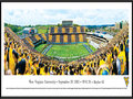 "Picture: West Virginia Mountaineers Mountaineer Field at Milan Puskar Stadium 2012 Big 12 Debut panoramic poster of the team's record setting 70-63 win over Baylor professionally framed. The highest scoring game in Big 12 history and what a debut as Geno Smith throws for 656 yards and eight touchdowns! This panorama, taken by Christopher Gjevre, captures the West Virginia Mountaineers making their Big 12 debut against the Baylor Bears. Mountaineer fans marked the event with the first-ever ""Stripe the Stadium"" promotion and wore either gold or blue, based on where they were sitting in the stadium. In addition to the Mountaineers' success on the field, Homecoming festivities added to the jubilation in Morgantown. The first football homecoming celebrations date back to 1921, with the first Homecoming queen crowned in 1939. The West Virginia Mountaineers play football at Mountaineer Field at Milan Puskar Stadium, which opened in 1980 and seats 60,000 fans."