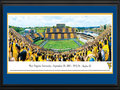"Picture: West Virginia Mountaineers Mountaineer Field at Milan Puskar Stadium 2012 Big 12 Debut panoramic poster of the team's record setting 70-63 win over Baylor professionally double matted in team colors and framed. The highest scoring game in Big 12 history and what a debut as Geno Smith throws for 656 yards and eight touchdowns! This panorama, taken by Christopher Gjevre, captures the West Virginia Mountaineers making their Big 12 debut against the Baylor Bears. Mountaineer fans marked the event with the first-ever ""Stripe the Stadium"" promotion and wore either gold or blue, based on where they were sitting in the stadium. In addition to the Mountaineers' success on the field, Homecoming festivities added to the jubilation in Morgantown. The first football homecoming celebrations date back to 1921, with the first Homecoming queen crowned in 1939. The West Virginia Mountaineers play football at Mountaineer Field at Milan Puskar Stadium, which opened in 1980 and seats 60,000 fans."