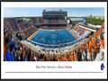 Picture: Boise State Broncos Bronco Stadium panoramic poster of the team's 2013 home opener, a 63-14 win over Tennessee-Martin in Chris Petersen's last year, professionally framed. This panorama of Bronco Stadium, taken by Christopher Gjevre, spotlights the Boise State Broncos football team playing their home opener against the University of Tennessee-Martin Skyhawks. This game also commemorates the opening of the Bleymaier Football Center, the Broncos new 70,000 square-foot athletic football complex in the north end zone. The Boise State players made their entrance onto the field through the new state-of-the-art complex, which houses a recruiting and players� lounge, a weight room big enough for the entire team to work out and, of course, it has the infamous blue turf. Boise State fans added to the game day festivities by striping the stadium.