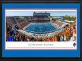 Picture: Boise State Broncos Bronco Stadium panoramic poster of the team's 2013 home opener, a 63-14 win over Tennessee-Martin in Chris Petersen's last year, professionally double matted in team colors and framed. This panorama of Bronco Stadium, taken by Christopher Gjevre, spotlights the Boise State Broncos football team playing their home opener against the University of Tennessee-Martin Skyhawks. This game also commemorates the opening of the Bleymaier Football Center, the Broncos new 70,000 square-foot athletic football complex in the north end zone. The Boise State players made their entrance onto the field through the new state-of-the-art complex, which houses a recruiting and players� lounge, a weight room big enough for the entire team to work out and, of course, it has the infamous blue turf. Boise State fans added to the game day festivities by striping the stadium.