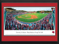 "Picture: Arkansas Razorbacks Baum Stadium at George Cole Field panoramic poster professionally double matted in team colors and framed. This panorama, taken by James Blakeway, captures the University of Arkansas baseball fans ""Calling the Hogs"" at Baum Stadium at George Cole Field. Considered a gold standard for college baseball facilities, Baum Stadium has undergone several renovations since opening in 1996. These renovations include an increase in the number of luxury suites to 34, while expanding the stadium to accommodate more than 11,000 Razorback fans. Arkansas began its 88th season of baseball in 2011 and continues to be recognized as one of the nation's elite programs. In testament to the program's popularity, in 2007, Arkansas became the first team in NCAA history to average more than 8,000 tickets sold per game."