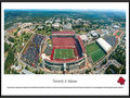 Picture: Arkansas Razorbacks Donald W. Reynolds Razorback Stadium panoramic poster professionally framed. This aerial panorama of the University of Arkansas was taken by James Blakeway during an Arkansas Razorback football game. Centered in the panorama is Donald W. Reynolds Razorback Stadium. Originally named Bailey Stadium in 1938, it was renamed Razorback Stadium in 1941. After a $20 million contribution to the 2001 stadium expansion by the Donald W. Reynolds Foundation, capacity increased to 72,000. The University, founded in 1871 in Fayetteville, Arkansas on a hilltop farm overlooking the Ozark Mountains, is home to one of the most beautiful assemblages of collegiate athletic venues in the Southeastern Conference, including Bud Walton Arena, the football practice fields and the John McDonnell Track Field.