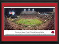 Picture: Arkansas Razorbacks Donald W. Reynolds Razorback Stadium panoramic poster professionally double matted in team colors and framed. This panorama of Donald W. Reynolds Razorback Stadium was taken by James Blakeway. The stadium opened in 1938 and was dedicated as Bailey Stadium. In 1941, it was renamed Razorback Stadium. The Reynolds name was added after a major contribution to the 2001 stadium renovation that increased capacity to 72,000. Today, the stadium boasts a new high definition video display to the north end zone, one of the biggest in college football. Arkansas also lays claim to the only Razorbacks in all of college athletics. Originally known as the Cardinals, the Razorbacks� nickname resulted after a big win over LSU in 1909, when the Arkansas football coach called his players �a wild band of Razorback hogs.�