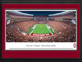 Picture: Alabama Crimson Tide Bryant Denny panoramic poster professionally double matted in team colors and framed. This panorama, photographed by James Blakeway, features the recently remodeled Bryant-Denny Stadium � home to the Alabama Crimson Tide football team. When the stadium was originally built in 1929, it seated 12,000 fans. Today, after eighty-one years and seven expansions, the stadium now seats 101, 821 fans. Located on the southwestern edge of the University of Alabama campus, the history-laden stadium ranks among the nation's top five on-campus football stadiums and is a fitting backdrop to the extraordinary football history of the Crimson Tide. The University, founded in 1831 in Tuscaloosa, Alabama, has a strong academic reputation with over 28,800 students.