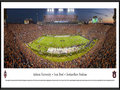 Picture: Auburn Tigers Jordan-Hare Stadium 2013 Iron Bowl win vs. Alabama on kickoff return game panoramic poster professionally framed. This panorama spotlights the Auburn Tigers making one of the touchdowns that clinched their spot in the SEC championship game, with a stunning victory over Alabama in the 2013 Iron Bowl. The game came down to the last play when the Tigers returned a missed field-goal attempt for more than 100 yards for a touchdown to lift No. 4 Auburn to a 34-28 victory over No. 1 Alabama. The Iron Bowl is the annual football rivalry played between the two largest public universities in the state of Alabama and this game was one of the most dramatic in the rivalry�s 78-year history, as the fans flooded the field in celebration. This panorama was taken by James Blakeway on November 30, 2013.