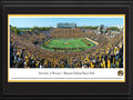 Picture: Missouri Tigers Memorial Stadium/Faurot Field panoramic print professionally double matted in team colors and framed. This panorama, taken by James Blakeway, spotlights a blaze of gold as the University of Missouri Tigers crushed their second consecutive ranked opponent for the first time since 1976. Playing on home turf, the Tigers defeated the Florida Gators with a final score of 36-17. The storied history of Memorial Stadium/Faurot Field, also known as �The Zou,� dates back to its opening in 1926. Today, fans enjoy the many changes to the stadium that have occurred, including an expansion to the north concourse area and moving the hill closer to the field. In the process, the Rock M was safely stored and reconstructed to maintain the important historical landmark that Tiger fans have grown to love.