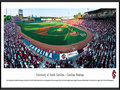 Picture: South Carolina Gamecocks Carolina Stadium panoramic print professionally framed. This panorama, taken by James Blakeway, captures the University of South Carolina baseball team playing for a win on their home field at Carolina Stadium. Unveiled in 2009 and located adjacent to the Congaree River, Carolina Stadium is considered one of the top college baseball stadiums in the United States, with a seating capacity for over 9,000 fans. The Gamecocks are one of the best teams in college baseball with an impressive record including regular NCAA Tournament participation and College World Series (CWS) appearances. In 2010, the Gamecocks became the first team to win six straight games in a World Series and the third team to win the CWS after losing its first game of the series.