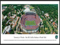 "Picture: Florida Gators Ben Hill Griffin Stadium panoramic print professionally framed. This panorama of Ben Hill Griffin Stadium at Florida Field was taken by James Blakeway during a Florida Gators football game. Known as Florida Field for 59 years, in 1989 it was renamed in honor of citrus grower and major school supporter Ben Hill Griffin, Jr. Nicknamed ""The Swamp"", it holds over 88,000 seats. The stadium lives up to its haunting nickname with temperatures reaching a humid 100 degrees. The size and excitement of the fans concentrates the noise at field level, making it one of the loudest stadiums in America. It has been regularly ranked as one of the toughest places to play. The university, founded in 1853 in Gainesville, Florida, has over 51,000 students."