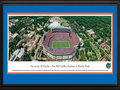 "Picture: Florida Gators Ben Hill Griffin Stadium panoramic print professionally double matted in team colors and framed. This panorama of Ben Hill Griffin Stadium at Florida Field was taken by James Blakeway during a Florida Gators football game. Known as Florida Field for 59 years, in 1989 it was renamed in honor of citrus grower and major school supporter Ben Hill Griffin, Jr. Nicknamed ""The Swamp"", it holds over 88,000 seats. The stadium lives up to its haunting nickname with temperatures reaching a humid 100 degrees. The size and excitement of the fans concentrates the noise at field level, making it one of the loudest stadiums in America. It has been regularly ranked as one of the toughest places to play. The university, founded in 1853 in Gainesville, Florida, has over 51,000 students."