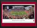 Picture: Washington State Cougars Martin Stadium 13.5 X 40 panoramic poster professionally double matted in team colors and framed to 18 X 44. This panorama, taken by James Simmons, showcases the Washington State Cougars football team playing to a packed house at Martin Stadium. The venue has undergone renovations, including a significant addition completed prior to the 2014 season. It resulted in a new Football Operations Building that houses a locker room, weight room, training area, dining facilities, coaches� offices and team rooms. The year prior, a state-of-the-art video display and audio system was installed, along with premium seating and a media center in 2012, making this one of the premier venues in college athletics.