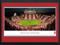 Picture: Utah Utes Rice-Eccles Stadium 13.5 X 40 panoramic poster against in-state rival Utah State Aggies professionally double matted in Utes' colors and framed to 18 X 44. his panorama, taken by Christopher Gjevre, captures the Utah Utes football team playing its season opener against in-state opponent, the Utah State Aggies. Utah and Utah State is the oldest rivalry in Utah football history, with the two schools competing in over 110 games since 1892. While the Utes and Aggies no longer compete in the same conference, the two programs will continue to face one another in competition. The Utah football program began in 1892 and has played home games at the beautiful Rice-Eccles Stadium since 1927. This game marked Utah's first-ever �Stripe the Stadium� promotion, asking Ute fans to wear either red or white, depending on the location of their seats.