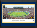 Picture: California Golden Bears Memorial Stadium 13.5 X 40 panoramic poster professionally double matted in team colors and framed to 18 X 44. This panorama, taken by Christopher Gjevre, brings to focus the on-field action of the University of California Golden Bears football team playing their first regular season game in the $321 million newly renovated California Memorial Stadium, also known as Memorial Stadium. Since its opening in 1923, Memorial Stadium has treated fans of all ages to many of the greatest games in the history of Cal football. Today, the Stadium is retrofitted for the 21st century, with fan safety in mind, while maintaining the architecture and character of the historic structure. State-of-the-art video and ribbon boards complete the modernization of the Stadium by greeting fans as they arrive and greatly enhancing their in-game experience.
