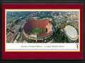 Picture: USC Trojans Los Angeles Memorial Coliseum 13.5 X 40 panoramic poster professionally double matted in team colors and framed to 18 X 44. This panorama, photographed by Christopher Gjevre, captures the USC Trojans football team playing on their home turf at Memorial Coliseum. Built in 1923, the Los Angeles Memorial Coliseum, located on 17 acres in Exposition Park, is currently the sixth largest college football stadium with a capacity of 93,607. Established in 1888, the Pacific-10 Conference Trojans have been a football powerhouse, claiming 11 national titles, 37 conference titles, 46 bowl game appearances, and over 750 all-time wins. The University of Southern California, founded in 1880 in Los Angeles, California, is California's oldest private research university. Today, enrollment exceeds 33,500 students.