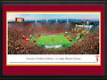"Picture: USC Trojans Los Angeles Memorial Coliseum 13.5 X 40 panoramic poster professionally double matted in team colors and framed to 18 X 44. This panorama, photographed by Christopher Gjevre, captures the University of Southern California Trojans battling a Pac-12 conference opponent. The USC Trojans football program, established in 1888, is a football powerhouse with more players selected for the NFL Draft than any other university. In 2009, the Trojans were named ""Team of the Decade"" by CBS Sports and ""Program of the Decade"" by Sports Illustrated. USC is the oldest private research university in the western United States, with two main campuses in the Los Angeles area. The Trojan Family consists of more than 240,000 living alumni in positions of leadership all over the world."