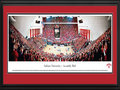 "Picture: Indiana Hoosiers Assembly Hall 13.5 X 40 panoramic poster professionally double matted in team colors and framed to 18 X 44. This panorama, taken by James Blakeway, captures the Indiana Hoosiers impressive win over the North Carolina Tarheels, and the first night of the season's ACC/Big Ten Challenge between two of the most storied programs in all of college basketball. Adding to the evening festivities at Assembly Hall in Bloomington, Indiana, Hoosier fans were dressed in red to celebrate the ""Red Out"" game and, as tradition has dictated since 1979, the William Tell Overture played during the third time-out of the second half of the game. The Hoosiers have been part of the Big Ten Conference since 1899, fielded their first men's basketball team in the 1900-01 season and hold a long history of winning achievements."