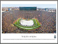 "Picture: Michigan Wolverines vs. Michigan State Spartans Michigan Stadium 13 X 40 panoramic print professionally framed to 13.75 X 40.25. This panorama, taken by James Blakeway, captures the college ice hockey game between long-time rivals � the University of Michigan and Michigan State University. The match-up, known as ""The Big Chill at the Big House,"" was held at Michigan Stadium on December 11, 2010. The event set a new world record for the largest crowd at an outdoor ice hockey game with attendance of 113,411. The past record set in May 2010, at the International Ice Hockey Federation (IIHF) World Championship game, was 77,803. This is the second outdoor ice hockey game to be played between the two storied programs. The first game, also a resounding success, occurred in 2001 and was referred to as the ""Cold War."""