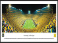 Picture: Michigan Wolverines Michigan Stadium 13.5 X 40 panoramic print professionally framed. This panorama, taken by James Blakeway, captures a historical moment as the Michigan Wolverines played their first night game at the Big House on September 10, 2011. The event set a new Michigan Stadium and NCAA attendance record with a crowd of 114,804 fans. To further celebrate the occasion, the team wore �legacy' uniforms highlighting design elements from past eras, including a large �M' on the front of the jersey and numbers on the sides of the helmet. In the 39th meeting between the schools, Michigan defeated Notre Dame 35-31 with the final touchdown recorded in the last seconds of the game. Michigan now holds a 23-15-1 advantage in the classic rivalry.