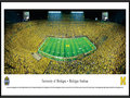 Picture: Michigan Wolverines Michigan Stadium 13.5 X 40 panoramic print professionally framed. Considered among the most elite of college programs, this panorama memorializes the Michigan-Notre Dame football rivalry at its finest. The historic first game between the Michigan Wolverines and the Notre Dame Fighting Irish dates back to 1887, with the Wolverines winning the first eight contests. Fast forward 125+ years and, in front of a NCAA-record crowd of 115,109, the Wolverines once again were victorious with a final score of 41-30. This game, �Under the Lights II,� was only the second night game ever played at the Big House. Michigan currently ranks ahead of Notre Dame in both winning percentage and all time wins.