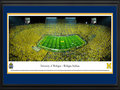 Picture: Michigan Wolverines Michigan Stadium 13.5 X 40 panoramic print professionally double matted in team colors and framed to 18 X 44. Considered among the most elite of college programs, this panorama memorializes the Michigan-Notre Dame football rivalry at its finest. The historic first game between the Michigan Wolverines and the Notre Dame Fighting Irish dates back to 1887, with the Wolverines winning the first eight contests. Fast forward 125+ years and, in front of a NCAA-record crowd of 115,109, the Wolverines once again were victorious with a final score of 41-30. This game, �Under the Lights II,� was only the second night game ever played at the Big House. Michigan currently ranks ahead of Notre Dame in both winning percentage and all time wins.
