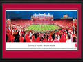 Picture: Nebraska Cornhuskers Memorial Stadium 13 X 40 panoramic print professionally double matted in team colors and framed to 18 X 44. This panorama, taken by Robert Pettit, captures the Nebraska Cornhuskers history-making evening as they hosted their first-ever Big Ten Conference home game at Memorial Stadium. The Huskers kept their poise and rallied for the biggest comeback in Nebraska football history for a win over the Ohio State Buckeyes with a final score of 34-27. Homecoming festivities added to the jubilation in Lincoln. Memorial Stadium has been sold out every game since November 3, 1962 and has recorded more wins than any other college football program since that date. In 2011, Nebraska switched conference membership from the Big 12 to the Big Ten Conference.