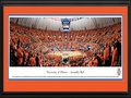"Picture: Illinois Fighting Illini Assembly Hall 13 X 40 panoramic print professionally double matted in team colors and framed to 18 X 44. This panorama, taken by Christopher Gjevre, captures the on-court action of the Fighting Illini basketball team as they play for a victory over North Carolina in the ACC/Big Ten Challenge game. The Fighting Illini men's and women's basketball teams play their home games at Assembly Hall in Champaign, Illinois. Assembly Hall has earned a reputation as one of the toughest places to play in college basketball, thanks to the student cheering section, the ""Orange Krush."" The University of Illinois at Urbana�Champaign is a public research university, situated on 1,468 acres in the twin cities of Champaign and Urbana, with annual student enrollment of over 41,000 students."