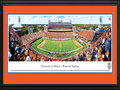 "Picture: Illinois Fighting Illini Memorial Stadium 13 X 40 panoramic print professionally double matted in team colors and framed to 18 X 44. This panorama, taken by James Blakeway, features the Fighting Illini football team playing on home turf at Memorial Stadium. This Homecoming Game and Big Ten season opener is also the battle for the ""Land of Lincoln"" rivalry trophy, which is presented to the winner of the annual football game between Illinois and Northwestern University. Homecoming at the University of Illinois is the longest continuously running tradition of its kind. The Homecoming tradition has been celebrated on the Illinois campus for more than 100 years, since the inaugural event in 1910. In its first Homecoming game, Illinois beat the University of Chicago, 3-0. The University was established in 1867."
