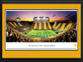 "Picture: Iowa Hawkeyes Kinnick Stadium 13 X 40 panoramic print professionally double matted in team colors and framed to 18 X 44. This panorama, photographed by Robert Pettit, captured the Iowa Hawkeyes football team playing the Black and Gold Spirit Game at Kinnick Stadium to a sold out crowd. The University of Iowa's fans showed their spirit by wearing gold in the even numbered sections and black in the odd sections, which gave them the opportunity to ""Paint the Town Black and Gold"" and ""stripe"" historic Kinnick Stadium in their school colors. Iowa Hawkeyes football was founded in 1889, completed its first undefeated season in 1899, and began competing in the Big Ten Conference in 1900. The University is located in Iowa City, Iowa, and is considered one of America's �Public Ivy' universities."