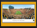 Picture: Iowa Hawkeyes Kinnick Stadium 13 X 40 panoramic print professionally double matted in team colors and framed to 18 X 44. This panorama, photographed by James Blakeway, spotlights the Iowa Hawkeyes football team playing a Big 10 Conference rival for a win and possession of the Floyd of Rosedale bronze pig trophy. One of the most famous trophies in all of college football, Floyd of Rosedale dates back to 1935, when Minnesota-Iowa governors agreed to award their state's prize pig to the winner of the football game. This game also marked the opening of the conference season in Iowa City and, the first time since 1979 that Iowa hosted Minnesota on Homecoming. Founded in 1847, The University of Iowa is the largest university in the state, with more than 30,000 students, but the smallest public institution in the Big Ten.