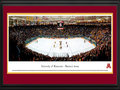 Picture: Minnesota Golden Gophers Mariucci Arena 13 X 40 panoramic print professionally double matted in team colors and framed to 18 X 44. This panorama of Mariucci Arena on the University of Minnesota campus, photographed by James Blakeway, features the Minnesota Golden Gopher hockey team playing WCHA rival University of Minnesota-Duluth. Mariucci Arena is named in honor of long time hockey coach John Mariucci, who was also a standout hockey and football player for the Gophers. Mariucci coached the Gophers from 1952 to 1966 with the exception of the 1955-1956 season. Dedicated in 1993, Mariucci Arena has a hockey game capacity of 10,000. University of Minnesota Hockey enjoys a long history, becoming a varsity sport in 1921. The Golden Gophers have won five national championships in men's hockey.
