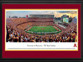 "Picture: Minnesota Golden Gophers TCF Bank Stadium 13 X 40 panoramic print professionally double matted in team colors and framed to 18 X 44. This panorama, photographed by Robert Pettit, captures the Minnesota Golden Gophers football team playing their first game at their beautiful new on-campus home - TCF Bank Stadium. The inaugural game was held on September 12, 2009. The Gophers were victorious against the United States Air Force Academy with a final score of 20 to 13. TCF Bank Stadium was built in a ""horseshoe"" design with incredible views of the Minneapolis skyline. The stadium, which seats 50,805, combines architectural elements from historic Memorial Stadium with the modern amenities of today's athletic venues. The Golden Gophers football team began play in 1882 and has won six national championships."