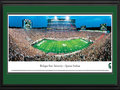 Picture: Michigan State Spartans Spartan Stadium 13 X 40 panoramic print professionally double matted in team colors and framed to 18 X 44. This panorama, taken by James Blakeway, features the Michigan State Spartans football team playing for a win against their ranked opponent in the season opener. This game also marks the first meeting between Michigan State and Boise State, two of the winningest NCAA Football Bowl Subdivision programs over the past two seasons prior to this game. The Spartans gained varsity football status in 1896 and moved into Spartan Stadium when it opened in 1923. Prior to the 2012 season, new high-definition video screens and scoreboards, a new LED ribbon board and a new sound system were installed in the Stadium. Spartan Stadium seats 75,005 fans, though 78,709 fans were in attendance at this game.