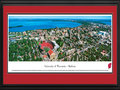 Picture: Wisconsin Badgers Camp Randall Stadium with beautiful Lake Mendota 13 X 40 panoramic print professionally double matted in team colors and framed to 18 X 44. This aerial panoramic photograph of the University of Wisconsin was taken by James Blakeway. It features the Madison Campus and Camp Randall Stadium during a Wisconsin Badgers football game. The university campus rests in a unique and beautiful setting on the shore of Lake Mendota. Featured at the far right is the Wisconsin State Capitol with its domed roof. Camp Randall Stadium, originally built in 1917, is the home for the University of Wisconsin Badgers football team. The current capacity of 80,321 ranks among the nation's largest school-owned stadiums and has ranked among the top 16 in the nation for attendance.